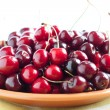Juicy and ripe cherry on a ceramic plate — Stock Photo #22860474