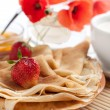 Royalty-Free Stock Photo: Fragrant golden pancakes and fresh milk