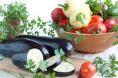 Fresh aubergines, whole and sliced — Stock Photo