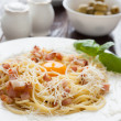 Spaghetti carbonara with grated parmesan cheese — Stock Photo