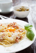 Spaghetti carbonara with egg yolk in the middle — Stock Photo