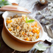 Stock Photo: Nutritious porridge from barley grains with vegetables