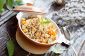 Nutritious porridge from barley grains with vegetables — Stock Photo