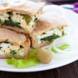 Stock Photo: Spring nutritious pie with eggs and spinach and onions