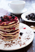 Mini berry cake with berries on top — Stock Photo