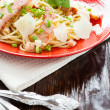 Spaghetti with pieces of bacon and parmesan - Stock Photo