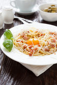 Tasty pasta carbonara with egg yolk in the middle — Stock Photo