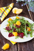 Salad with fresh greens, beets and oranges — Stock Photo