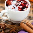 Mulled wine with almonds in a white cup - Stock Photo