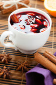 Mulled wine with almonds in a white cup — Stock Photo