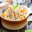 Flavorful and nutritious barley porridge in the pot — Stock Photo