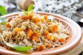 Barley porridge with chunks of root vegetables — Stock Photo