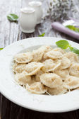 Delicious ravioli with basil and parmesan — Stock Photo