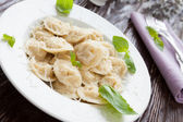Ravioli with basil and grated parmesan — Stock Photo