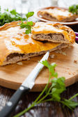 Nutritious rustic meat pie in a cut — Stock Photo