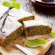 Poppy seed cake on a wooden board and knife — Stock Photo