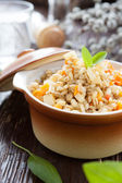 Pearl barley and carrots cooked in a pot — Stock Photo