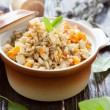 Stock Photo: Nutritious barley porridge with fried vegetables
