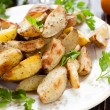 Stock Photo: Crispy roasted potato wedges with skin