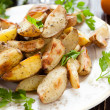 Crispy roasted potato wedges with skin — Stock Photo