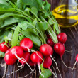 Fresh radish with leaves on the boards and cooking oil — Stock Photo