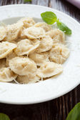 Homemade meat ravioli with grated parmesan cheese — Stock Photo