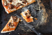 Small pieces of pizza with mushrooms — Stock Photo