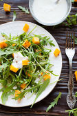 Salad with roasted pumpkin and yogurt — Stock Photo