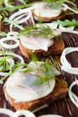 Herring on a piece of rye bread canapés — Fotografia Stock