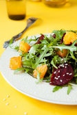 Fresh salad with arugula and orange — Stock Photo