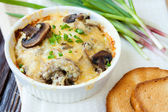 Mushrooms baked in the oven with grated cheese — Stock Photo