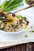 Rice casserole with mushrooms and cheese — Stock Photo