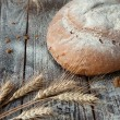Stock Photo: Round hearth bread on boards