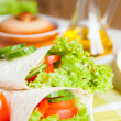 Fresh vegetables wrapped in Armenian lavash - Stock Photo