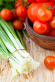 Fresh vegetables for salad, tomatoes and fresh herbs — Stock Photo