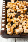 Bread croutons on a baking tray — Stock Photo