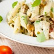 Stock Photo: Penne pastwith mussels and basil and cream