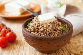 Buckwheat porridge with butter cream — Stock Photo