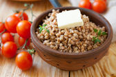 Crumbly buckwheat with butter — Stock Photo