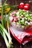 Fresh vegetable salad in a transparent bowl — Stock Photo