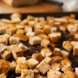 Dried in the oven bread cubes, croutons - ストック写真