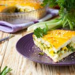 Piece of the pie stuffed with eggs and greens — Stock Photo #25451715
