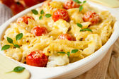 Pasta baked with cheese and tomatoes — Stock Photo