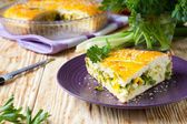 Piece of the pie stuffed with eggs and greens — Stock Photo