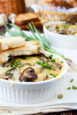 Mushroom julienne with white bread croutons — Stock Photo
