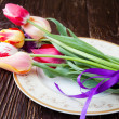 Armful of tulips on a plate — Stock Photo