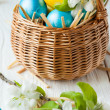 Wicker basket with easter eggs — Stock Photo
