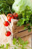 Fresh vegetables in wooden crate — Stock Photo