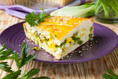 Large piece of of the pie with herbs and eggs — Stock Photo