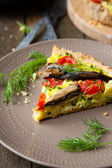 Slice of quiche with vegetables and fish, sprats — Stock Photo